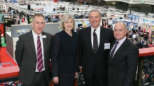 On the balcony above CTX 2014 are (from left) Clarion Events MD Tim Porter, Home Secretary and Maidenhead MP Theresa May, Admiral the Lord West of Spithead and Stephen Phipson CBE, Director Security Industry Engagement at HMG.